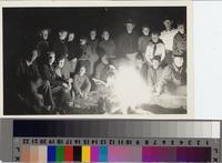 Boy Scout troop gathered around campfire [on Santa Catalina Island?] California...