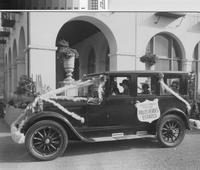Automobile decorated for celebration of newly opened highway, Palos Verdes Estates....